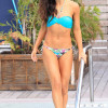 Karina Smirnoff in a blue print bikini as she suns herself in Miami